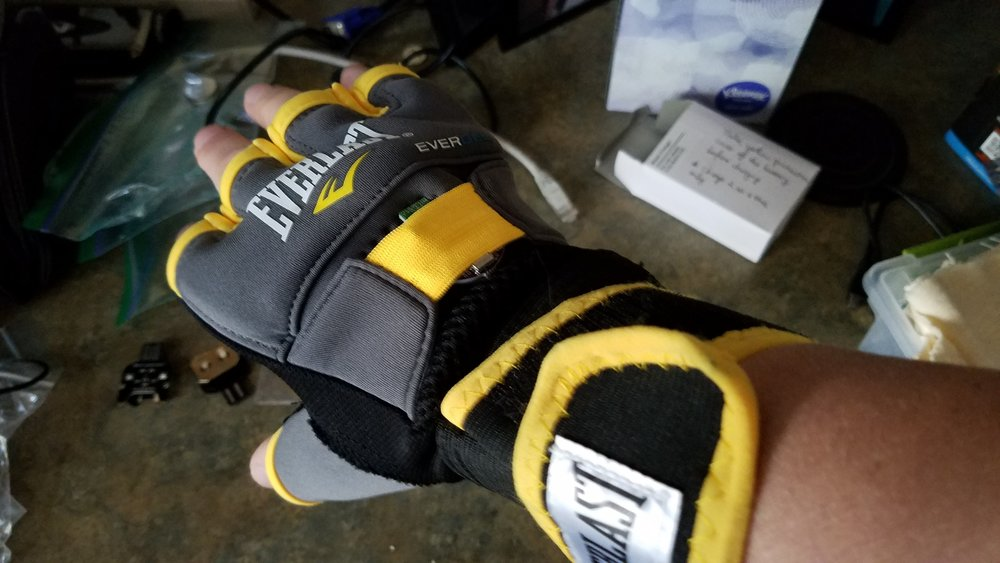 MMA glove - We're using one with a wrap-around the wrist; we put two Solitons in here. Another low-cost example here on Amazon
