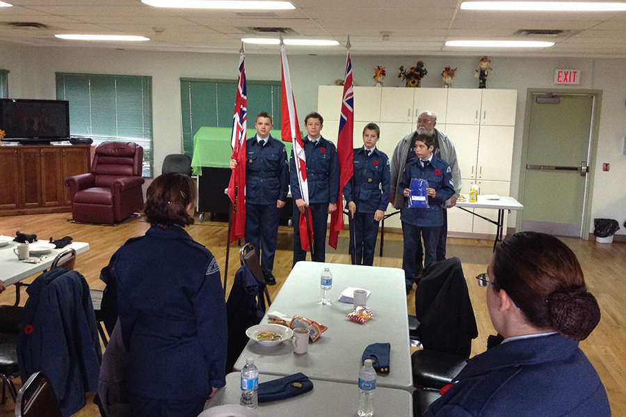 1 November 2014: President Patrick Golding presents new flags and poles to 379 Squadron Colour Party.