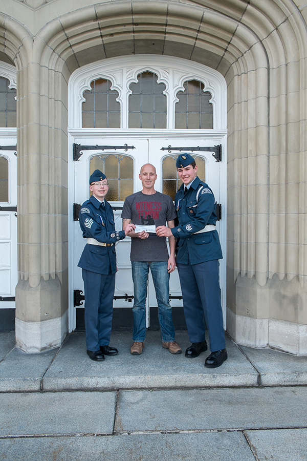 April 2014: Comrade Marius Bauer hands over a cheque with a $100 donation for the Cornwall Air cadet squadron 325 for helping us out with a bugle player for the Remembrance Day ceremony in Alexandria in the past 2 years.
