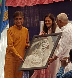 Gift of Buddha Bhagwan picture to Chandrakantbhai Vyas for the school's principal office.