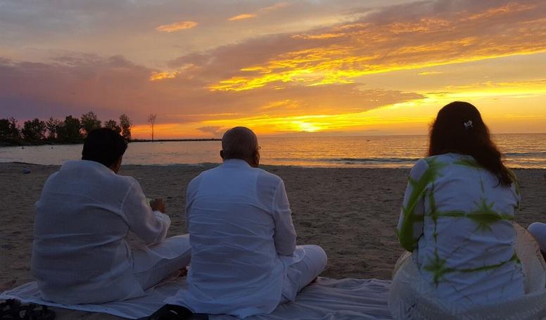 Bhaishree with Sunset.jpg