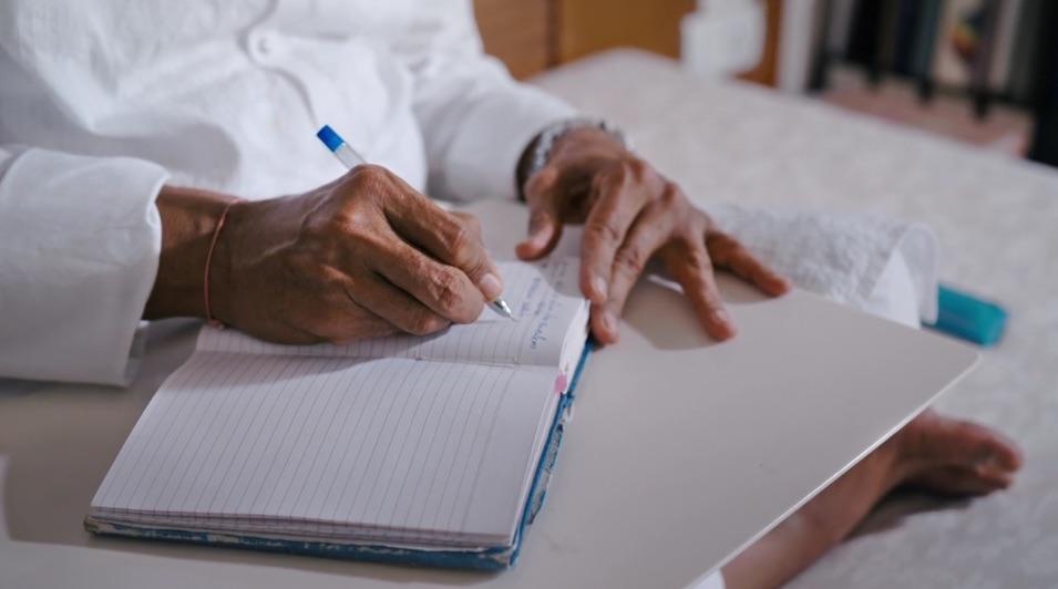 Bhaishree writing his diary 2.jpg