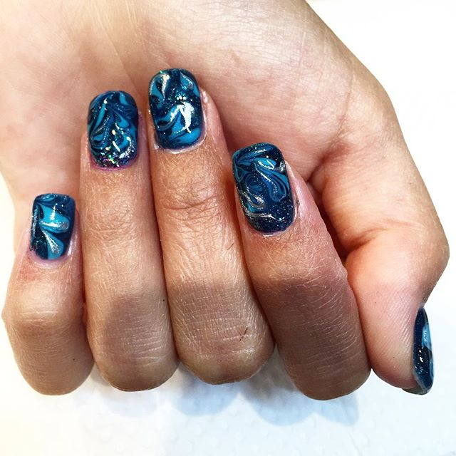 ✨Check out these beautiful funky nails by Simona! Come get a gel manicure and rock the fall look ✨ #Galaxy #nails #fallfun #gelmanicure
