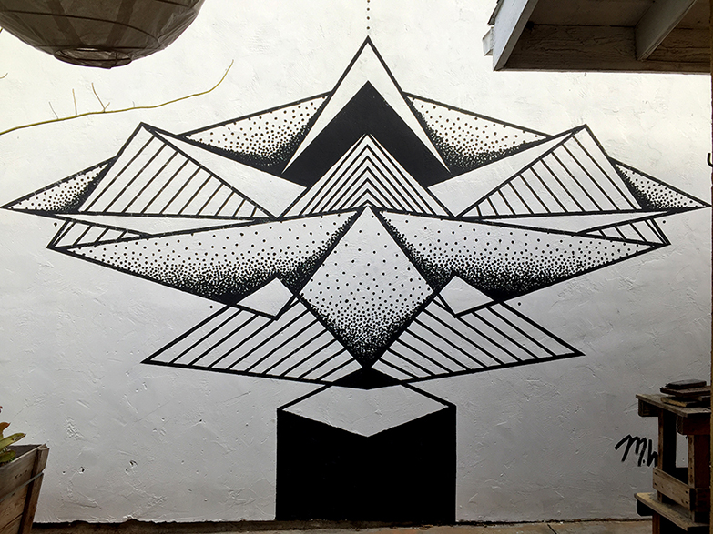 This is the first mural I painted. Translating my geometric style from the page to a large wall was a fun challenge. I kept the palette simple so that I could focus on the process and find the right techniques. I plan to paint over this piece soon to explore the use of spray paint. 10' x 15' (2016)