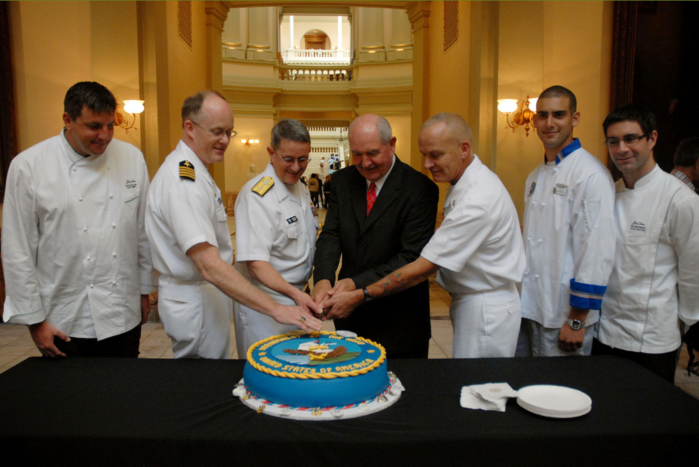 Members meet in the GA Capitol to see Governor Sunny Purdue and officers of the USS Georgia help cut the Navy Birthday Cake