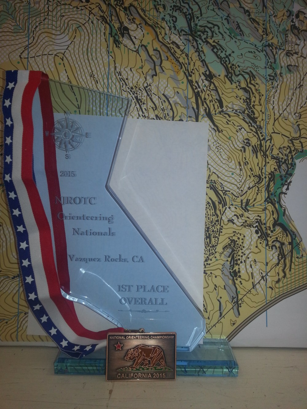 Orienteering medal and trophy.