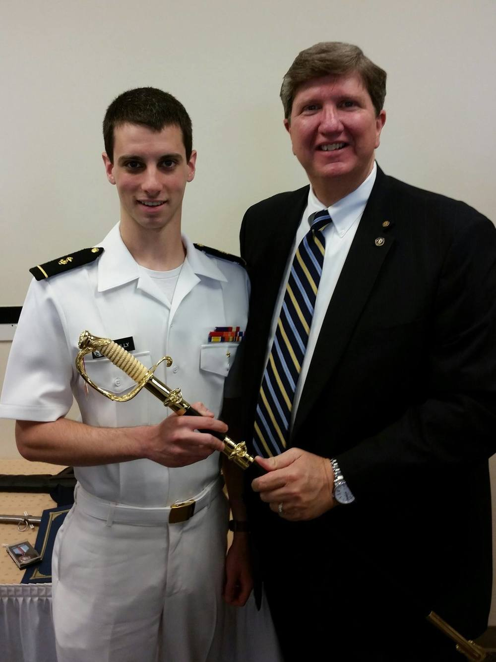 Council president Jeff alexander presented Midshipman Christopher O'Reilly  with a Naval Officer's Sword for his outstanding performance in the NROTC program at Georgia Tech.
