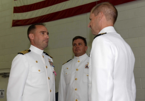 DOBBINS AIR RESERVE BASE, Ga. (July 11, 2015) Capt. David T. Fritz, the former commanding officer of Navy Operational Support Center Atlanta, stands at attention as the citation for his Legion of Merit award is read. At center is Capt. Ralph F. DeWalt, the new commanding officer; at right is Capt. Shawn Duane, the deputy commander of the Navy Reserve's Region Southeast. (U.S. Navy photo by Petty Officer 1st Class Adam C. Stapleton/Released)