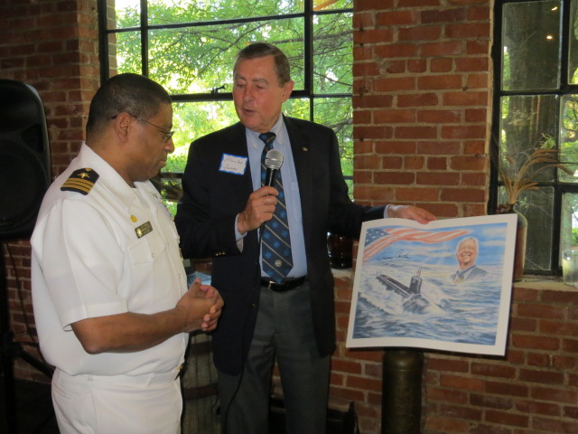 Council President Harley Jones presented CDR Steven Maxwell with a print of  President Carter