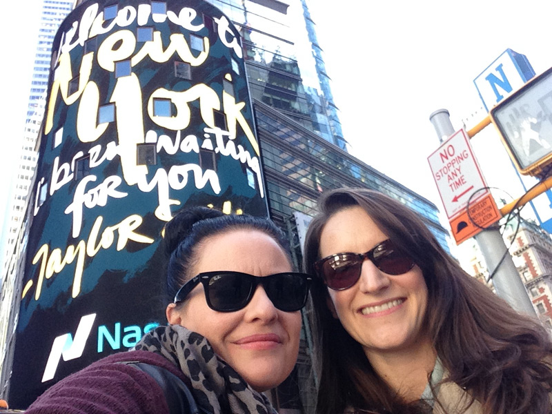 Just two professional New York City ladies watching their work on Times Square billboards, NBD.