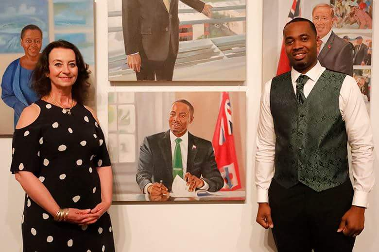 "Jane Masojada with David Burt, Premier of Bermuda, at the opening of ""The People of Bermuda"" at Masterworks Gallery"