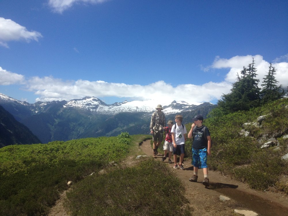 Students and one of their trip leaders hike along the Cascade Pass trail.
