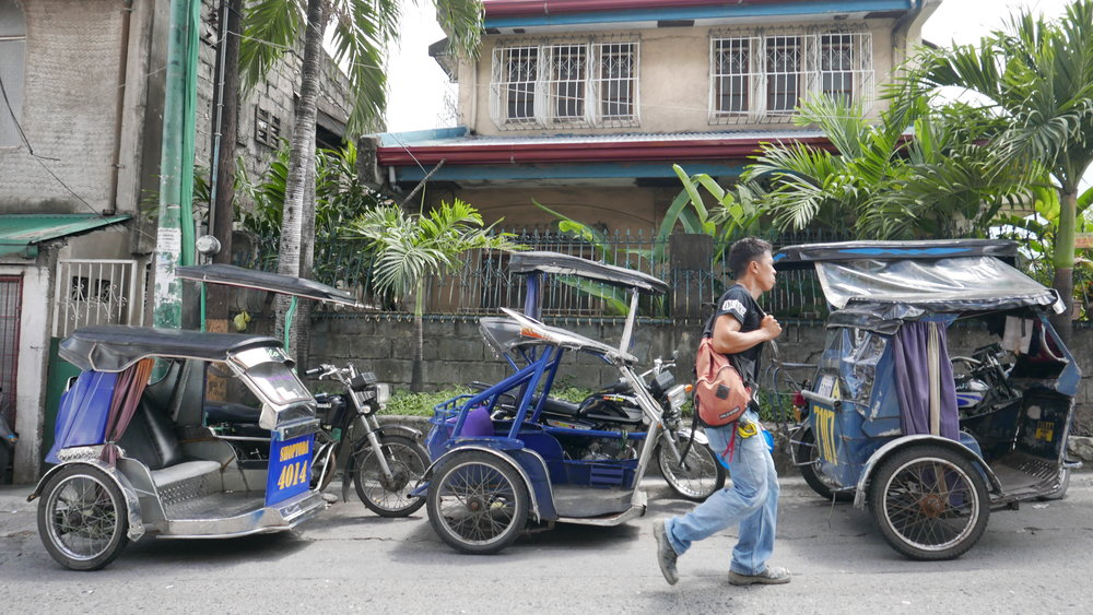 This docile looking trio must be wondering why this guy isn't taking a seat.  The tricycles (or pedicabs) dart through the narrow streets and alleys of Manila like nothing else.