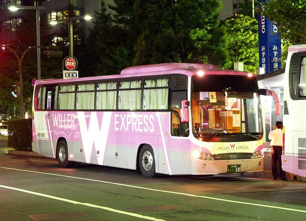 Overnight bus.  Yes, it's pink.