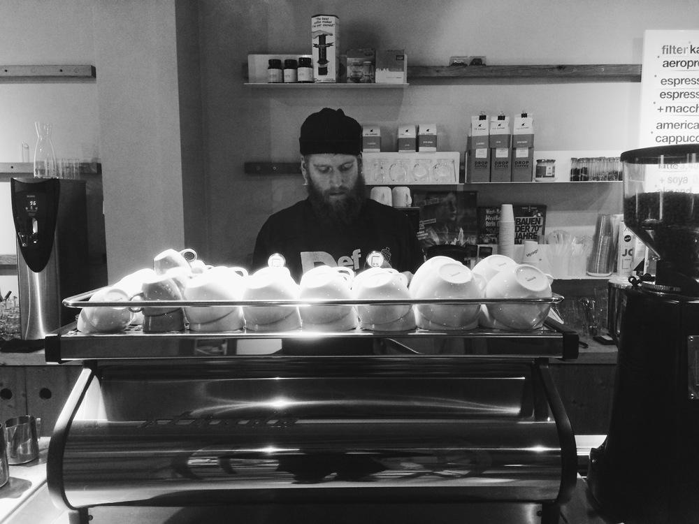 Barista at work behind westberlin's coffee preparation station.