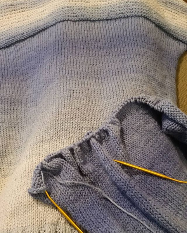 Working on my first knitted sweater! I have one side done. 2nd side half done. I taught myself how to knit last winter after crocheting for 38 years. The pattern is from @redheartyarns as well as the yarn. I'm using ombre yarn in the color Baja blue. Loving this. What do you think?