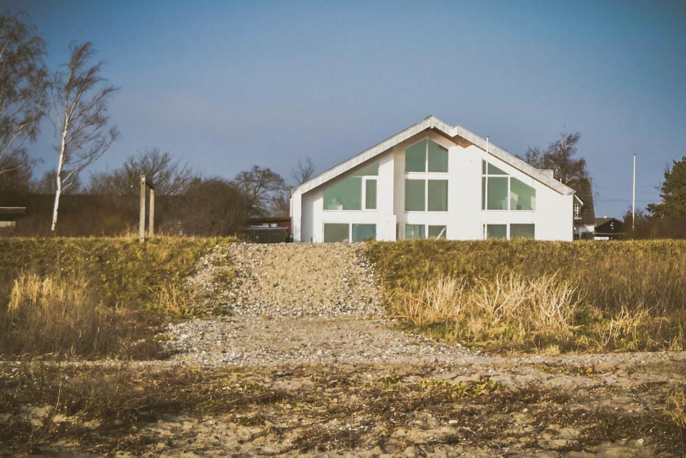 Forskjellige et hus, en strand, en hane, en søndag eftermiddag — idaege PU-63