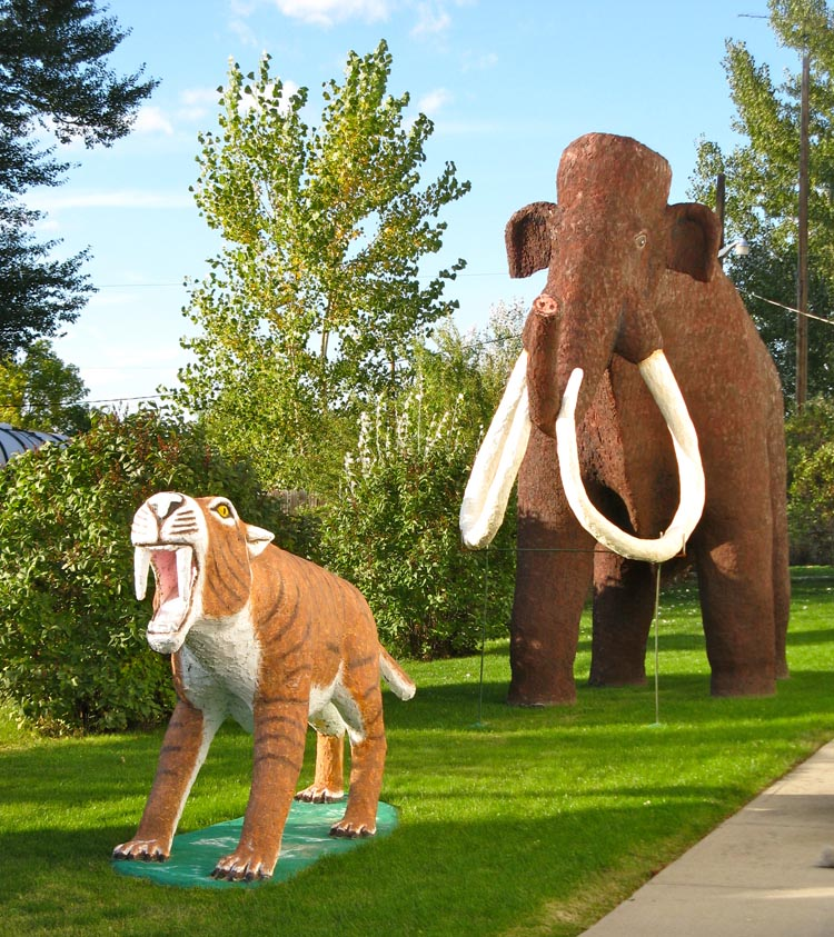 Danger! These terrifying beasts prowl in the garden of The Yucca Theatre; built in 1931 in Hysham, Montana, USA. They were made by local sculptor Bob Schulze.  Photo by Tom Kilmer.