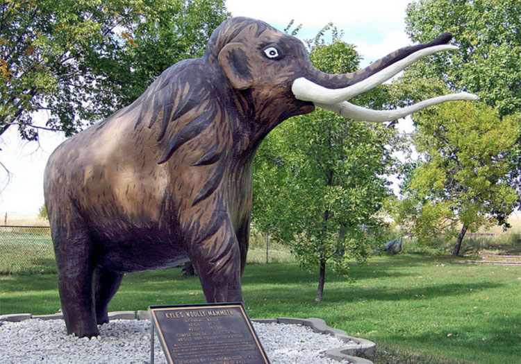 Made in 1981 in Kyle, Saskatchewan, Canada; Wally the concrete mammoth honours the 1964 discovery of mammoth bones in the area by road-builders. Photo by Gregory Melle.