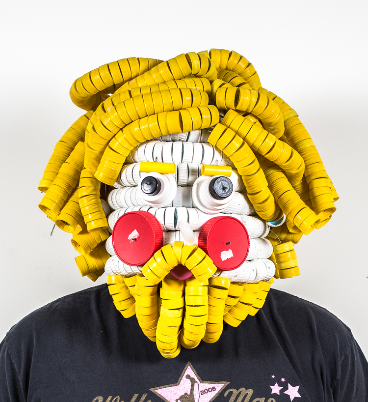 Alex Lockwood takes things like bottle caps or rubber balls and turns them into the most incredible and expressive masks or giant heads. We are huge fans. Check his feed here.
