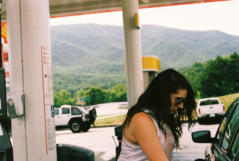Jersey girls pumping their own gas, with some gorgeous scenery in the background.