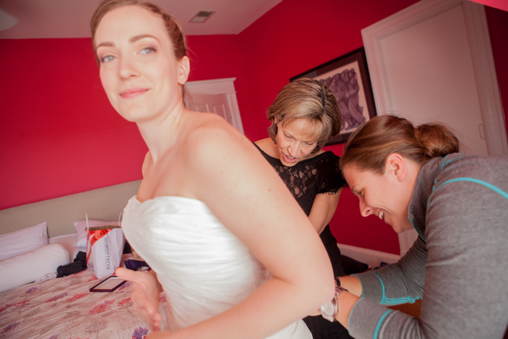 Megan gets into her dress with help from her mom and bridesmaid Kristen (who's wedding I'm shooting later this year!)