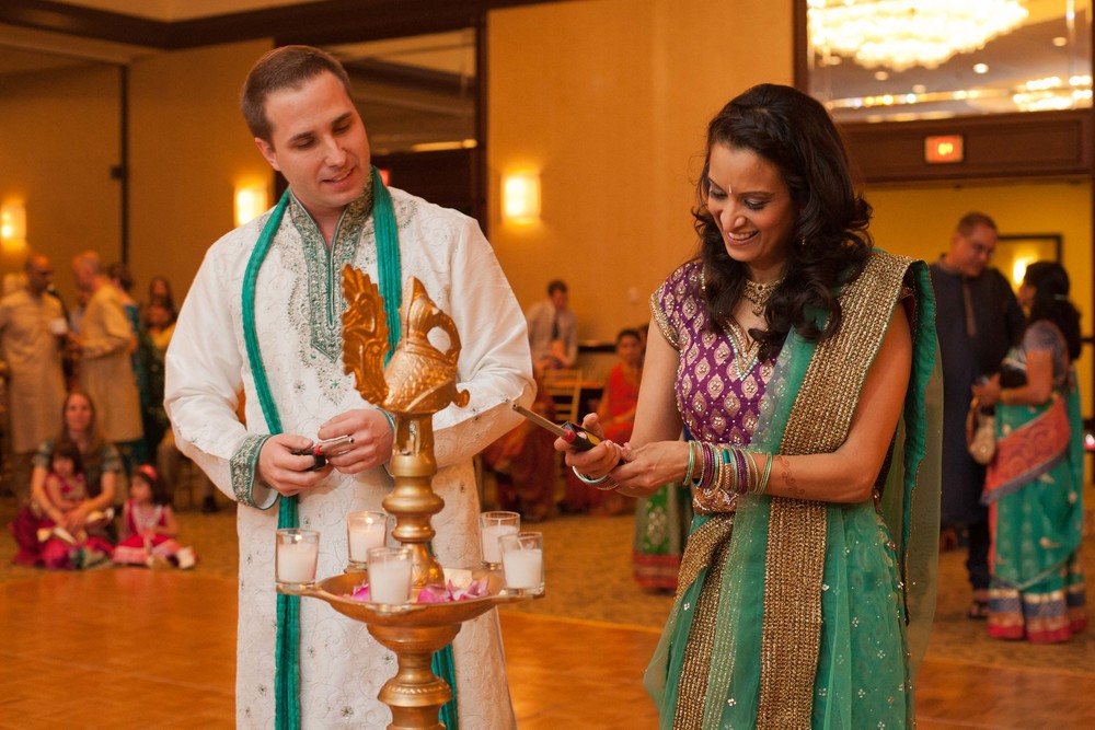 Matt and Aditi light the candles at the center of the dancefloor for the Garba portion of the night.