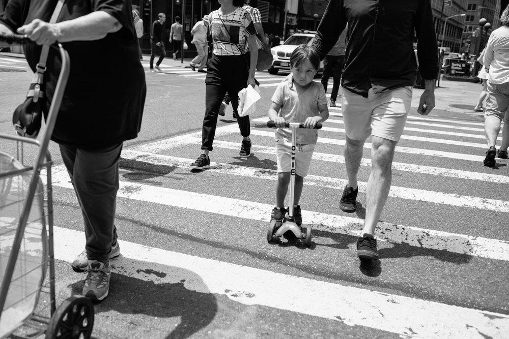little boy on scooter.jpg