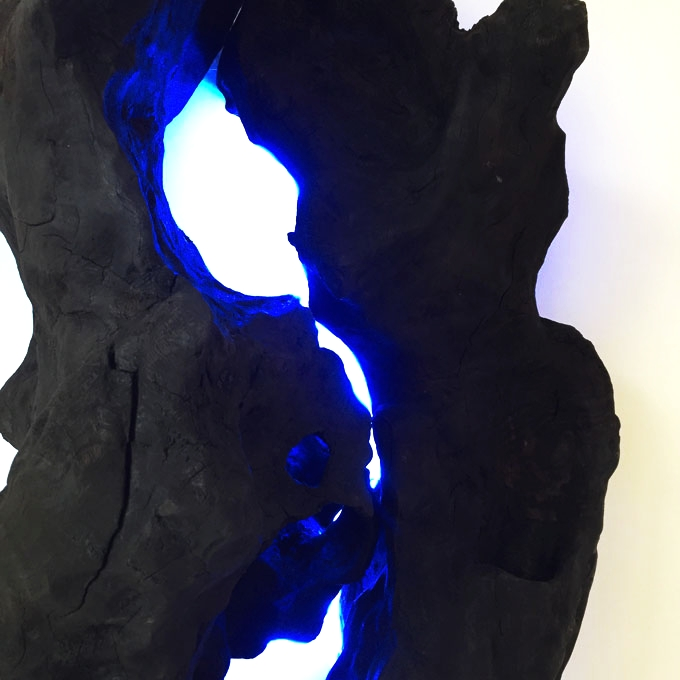 "Synapses - ""Objects aren't there so much to be contemplated as they are to create links between shadow, reflection and echo: inside or outside, close up or far away, before and after... "" Henri Olivier Henri Olivier, Synapse XI, 2017 - Charred olive tree stumps, neon."