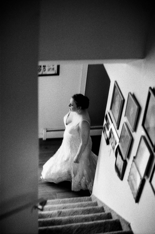 Bride in motion, 35mm B&W film.