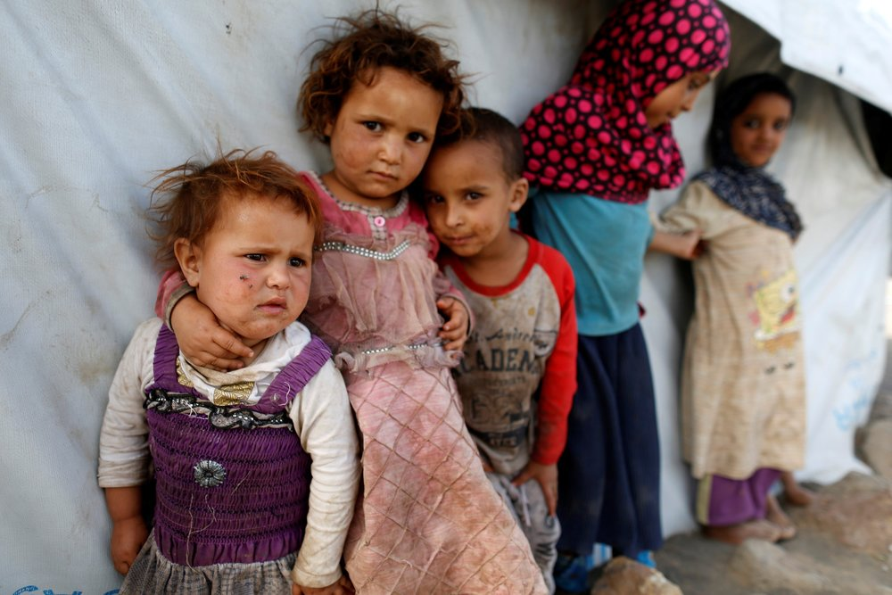 Children stand next to a tent at a camp for people displaced by the war near Sanaa, Yemen April 24, 2017. Credit: Reuters/Khaled Abdullah