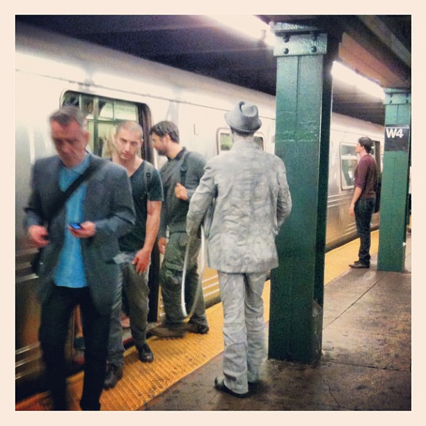 The Statue Man on the subway after a hard day's work of standing and posing and stuff! (Taken with  Instagram )