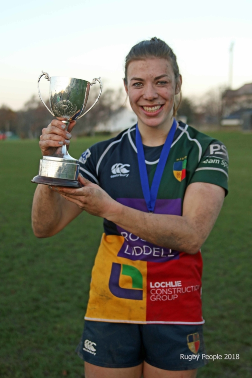 Louise McMillan lifts the League Trophy
