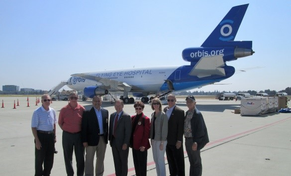 """ORBIS"" MD-10 at Moffett Field with San Francisco Commandery Companions-Sandy Lockwood, friend Bill Hawk, Allan Cruz, Bob Ranck, Michele Lockwood, Sarah Koller, Dennis Koller, and Bob Hansen."