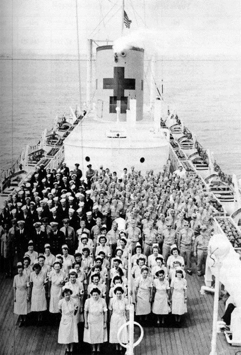USS  Comfort ( AH-6) crew and medical staff pose on deck prior to departing for the war zone on 29 May 1944 from San Pedro, California.