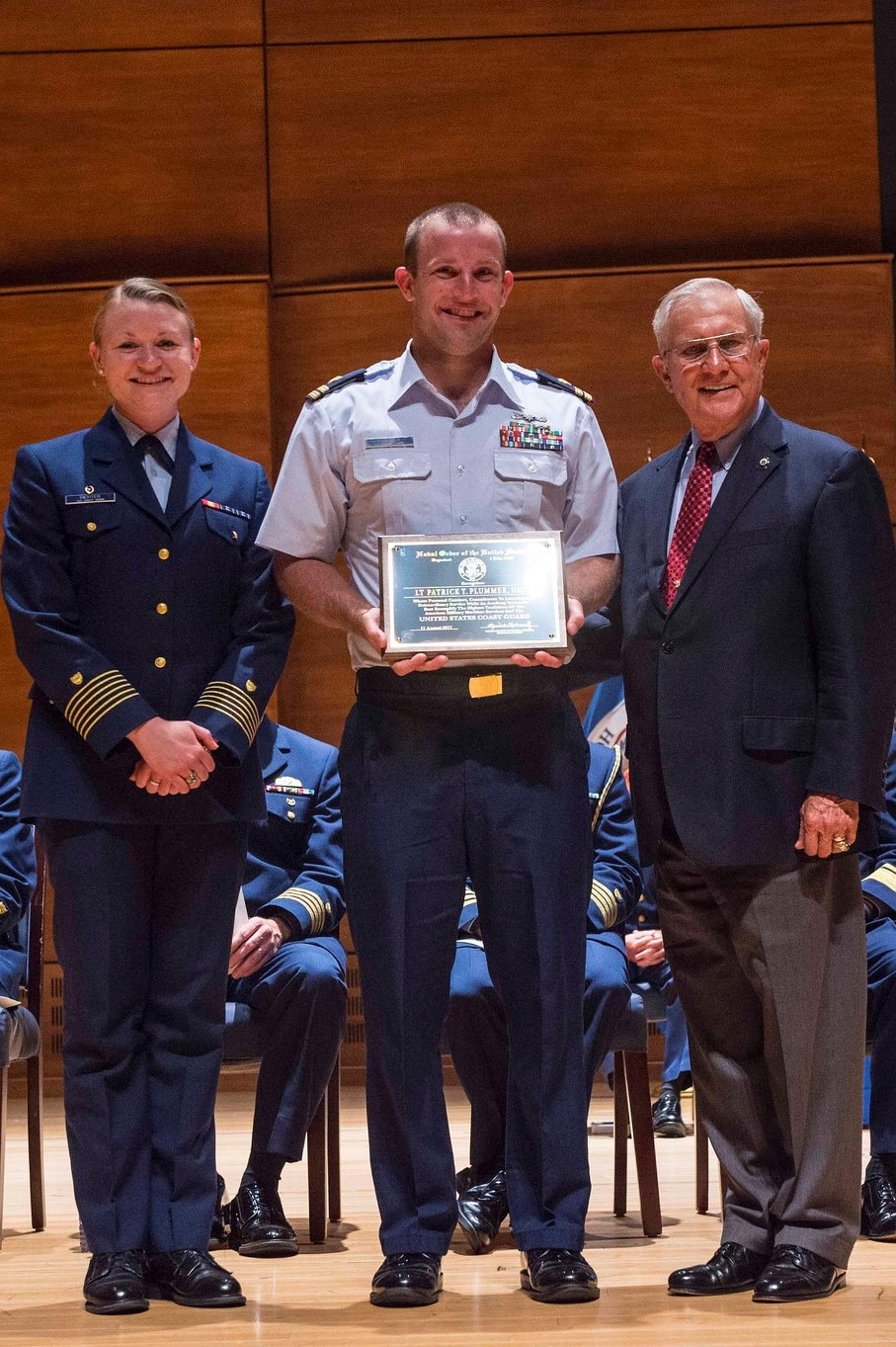 The 2017 USCGA JO Instructor of the year was presented to LT Patrick Plummer by RADM William F. Merlin, USCG (Ret) and the Regimental Commander, Cadet First Class Dakota Richter.