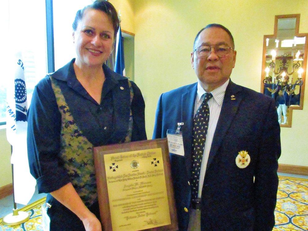 SgtMaj Angela M. Maness, USMC (Ret.)receives the Distinguished Sea Service Senior Enlisted Award, presented by COL Allan F.P. Cruz, USMC (Ret.)