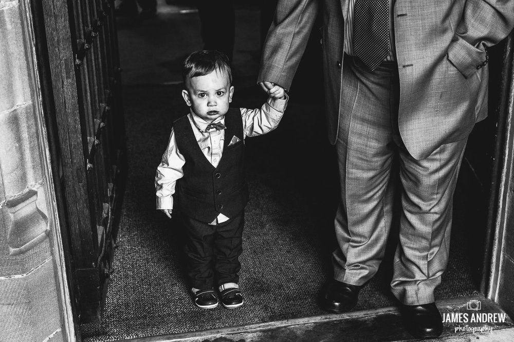 child holding grandads hand before wedding ceremony
