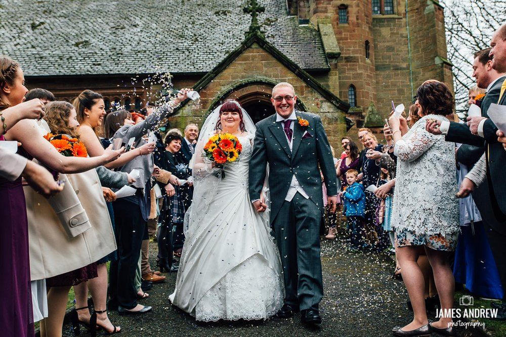 bride and groom just married leaving church confetti shot