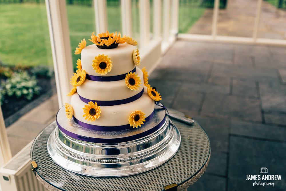 wedding cake three tier with sunflowers