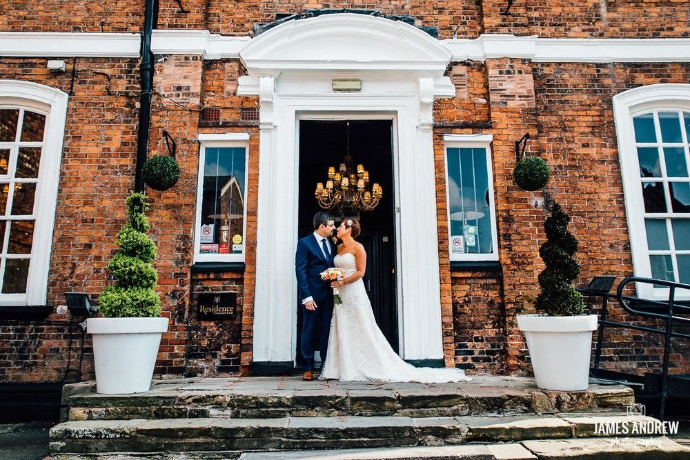bride and groom in front of wedding venue nantwich cheshire northwest