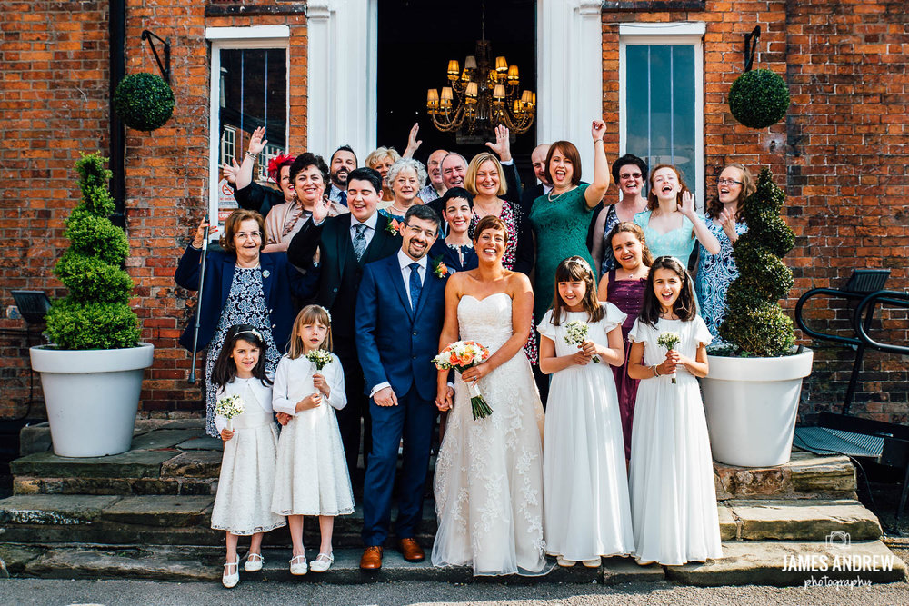 group picture of whole wedding party outside