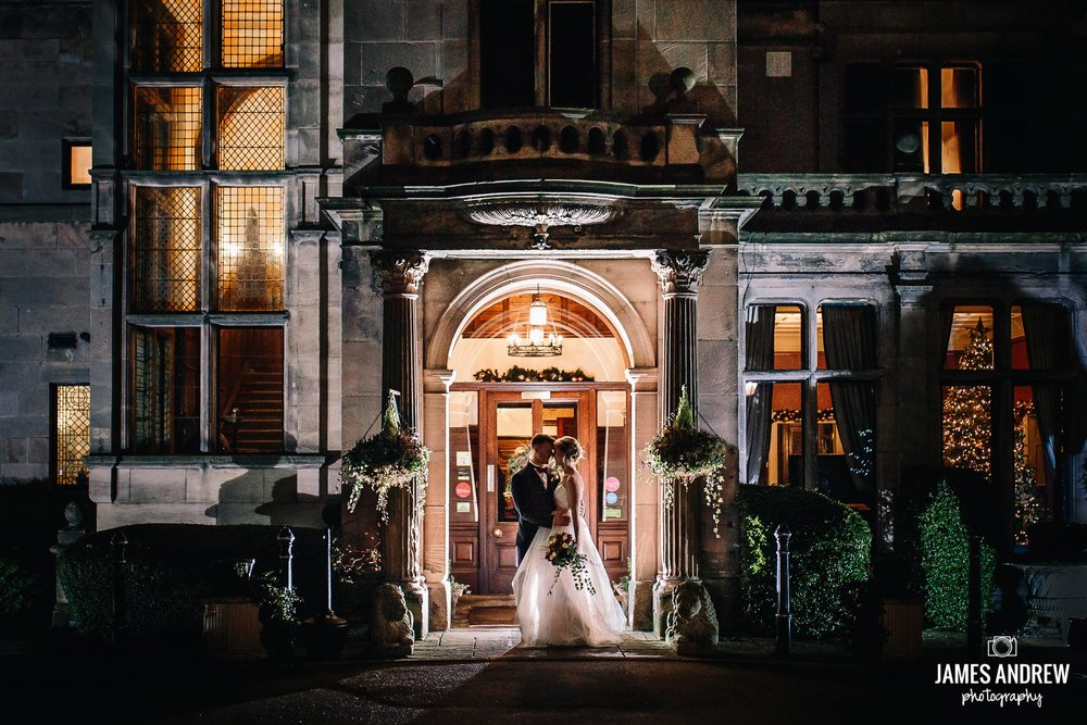 Bride And Groom Rookery Hall Doorway At Night creative portrait