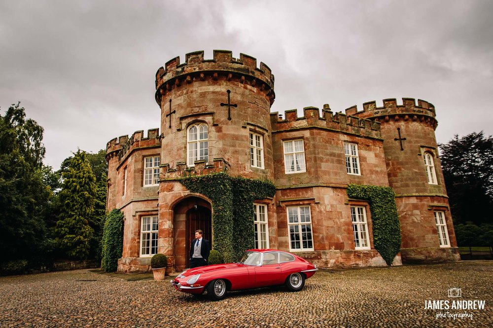 vintage wedding sports car red outside peckforton castle