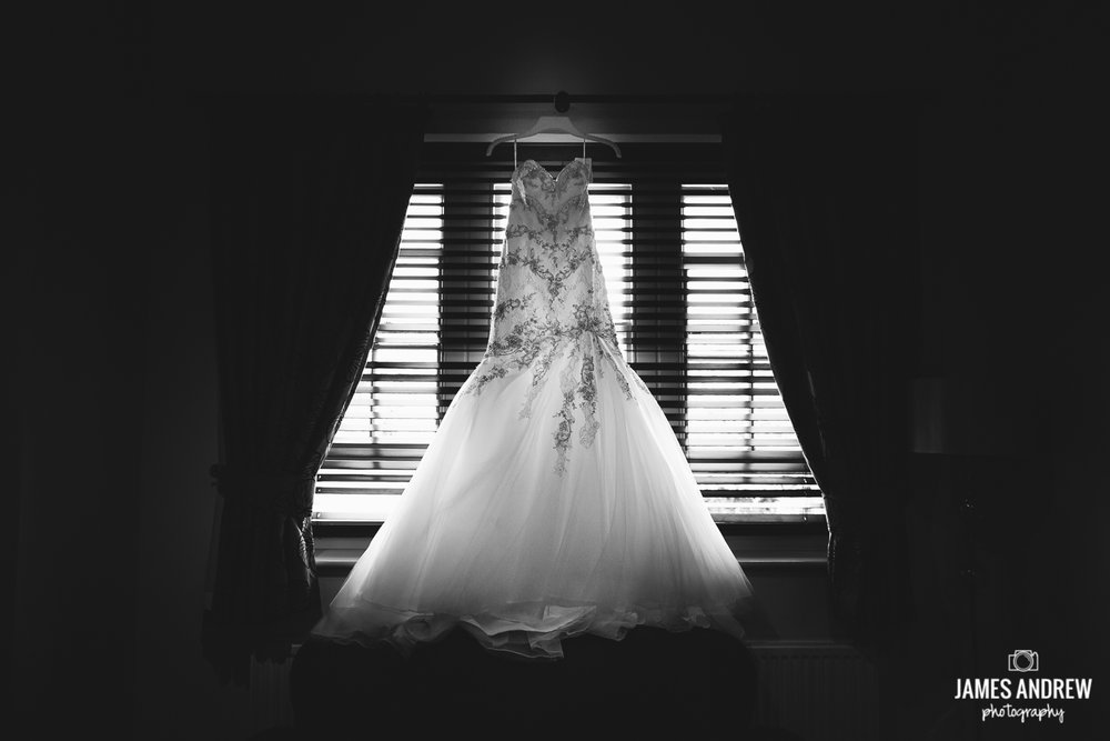 Wedding dress in window Cranage hall
