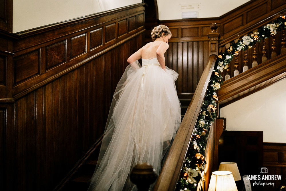 Bride running upstairs