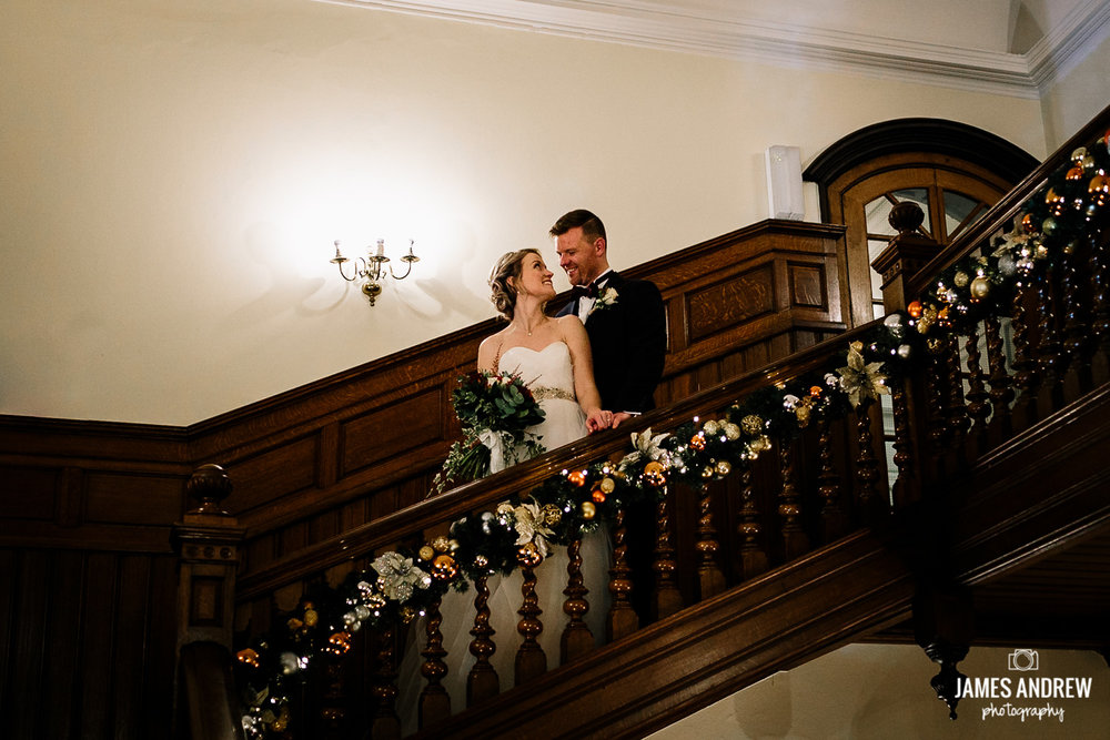 Bride and groom portrait on staircase