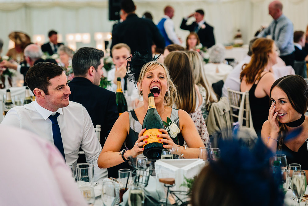 Weddings guest drink giant champagne bottle Cheshire
