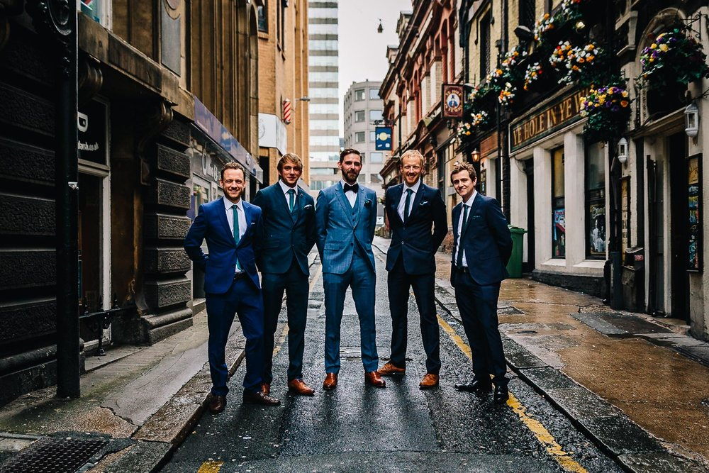 Alternative group photo groomsmen ushers groom city wedding