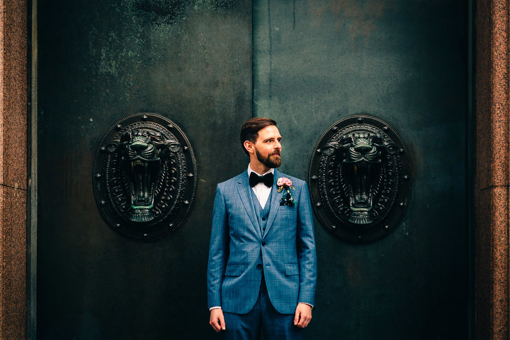 Creative groom portrait urban wedding